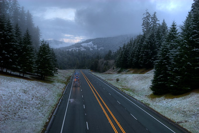 © Joseph Dougherty. All rights reserved.   Abnormally low elevation snowfall. A truck rolls up Highway 101, dusted with snow at an elevation of only 900 feet.