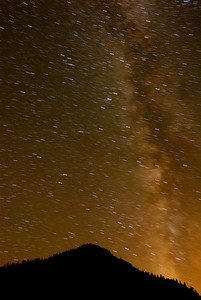 © Joseph Dougherty. All rights reserved.  The Milky Way and star streaks over the peaks surrounding Lake Tahoe.