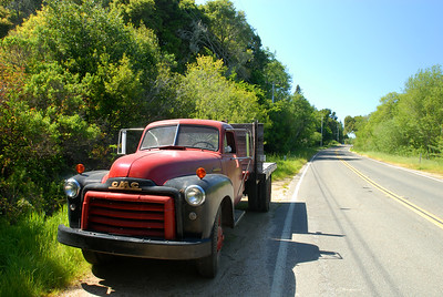 © Joseph Dougherty. All rights reserved.  Old truck parked along a back-country road.