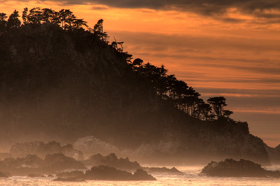 © Joseph Dougherty. All rights reserved.  Sunset and sea mist over breaking waves and rocky coastline.  Point Lobos State Park, California.