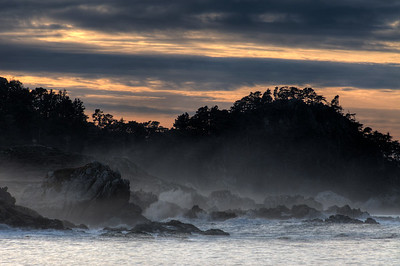 © Joseph Dougherty. All rights reserved.  Sunset with sea mist and breaking waves along rocky coastline.  Point Lobos State Park, California.