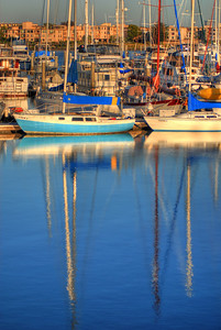 © Joseph Dougherty. All rights reserved.   Boats reflected in the San Francisco Bay.   Emery Marina, Emeryville, CA