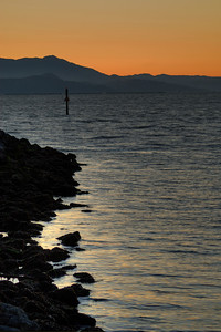 © Joseph Dougherty. All rights reserved.   East Bay shoreline, looking toward Mt. Tamalpais at sunset.
