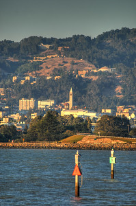 © Joseph Dougherty. All rights reserved.   The UC Berkeley campanile is distantly visible across the waters of Emery Bay.
