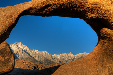 © Joseph Dougherty. All rights reserved.  The first rays of morning light hit eastern Sierra peaks, including Mt. Whitney and Mt. Muir.  Seen through the Alabama Hills Arch.