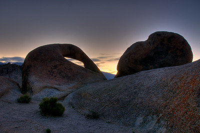 © Joseph Dougherty. All rights reserved.  Day breaks over the White Mountains, through the Alabama Hills Arch in the eastern Sierra.