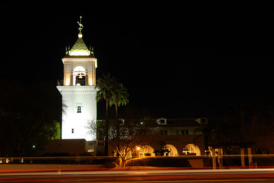 © Joseph Dougherty. All rights reserved.   Car lights streak past the bell tower at Desert Regional Medical Center in Palm Springs, CA.