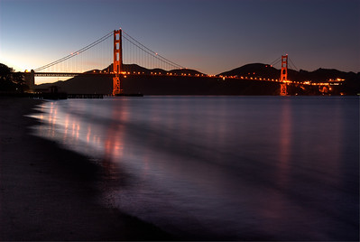 © Joseph Dougherty. All rights reserved.   Golden Gate Bridge after sunset. Soft twilight reflections.