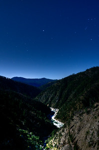 © Joseph Dougherty. All rights reserved.   Confluence of the Fall River meeting the Middle Fork Feather River, at night under full moon light on the hillsides.  Faint stars are nearly washed out by the moonlight.