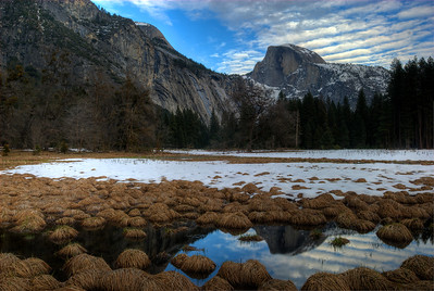 Half Dome reflected in snow melt pools on the valley floor, seen from Cook's Meadow.