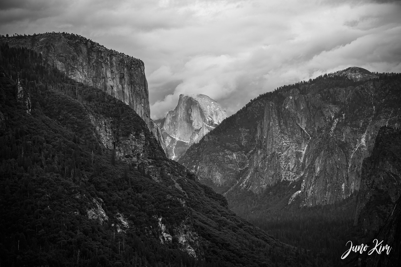 View of Half Dome through the valley. El Capitan stands on the left.