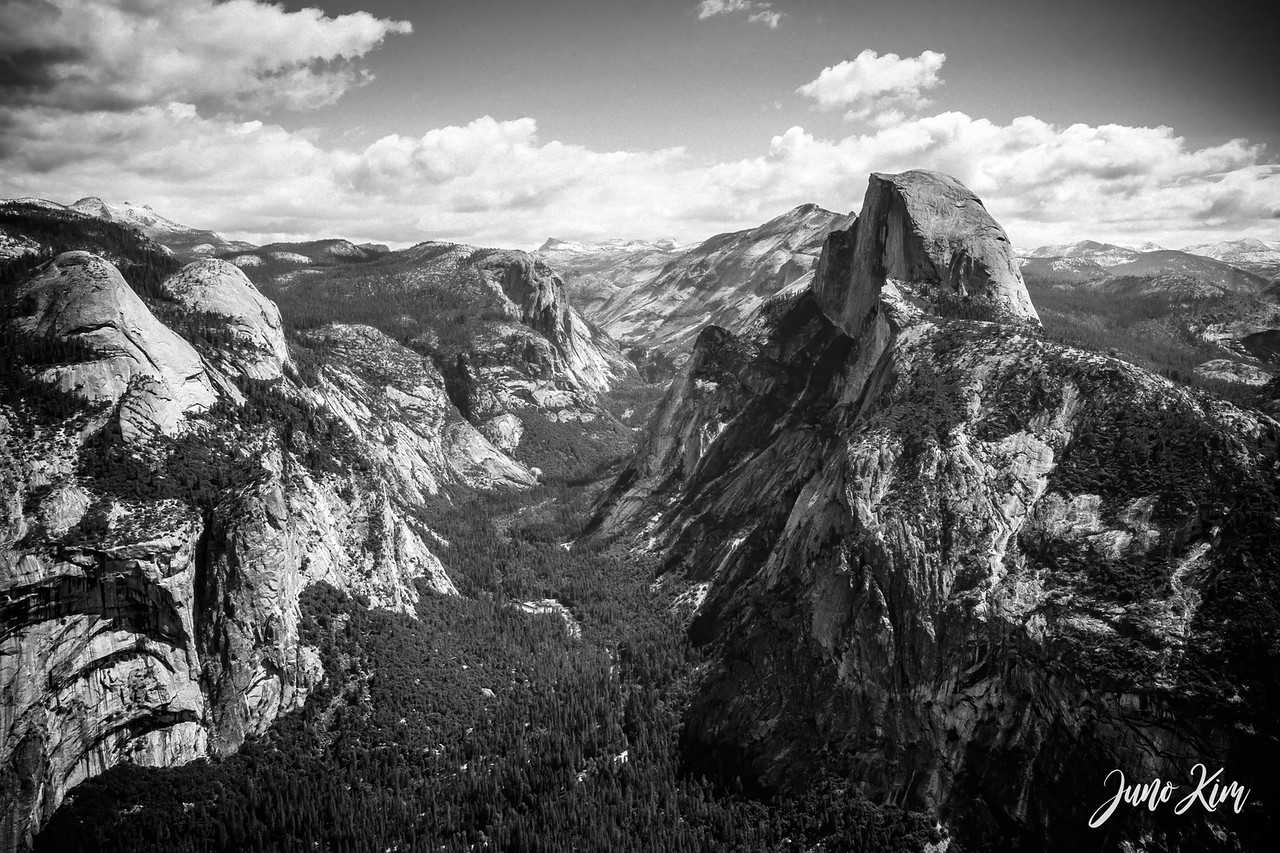 The view of Yosemite Valley from Glacier Point. Half Dome stands above all the peaks around the valley.