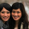 Two Taiwanese woman, studying in Boston, pose for an informal portrait.