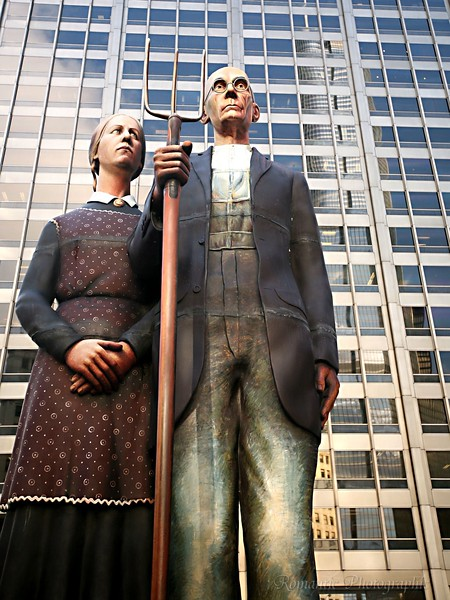 A three-dimensional version of American Gothic stands on Michigan Avenue.