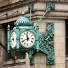 The ornate bronze clock outside of the Marshall Field department store.