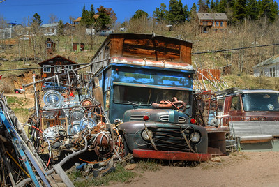 © Joseph Dougherty. All rights reserved.  In high mountain towns, you just never know what you're going to stumble across...  This old bus was converted into a home.  (I think the van was supposed to be some kind of room addition... or maybe the in-law unit.)