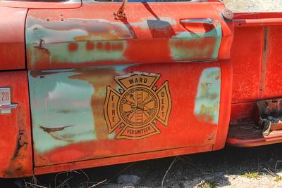 © Joseph Dougherty. All rights reserved.  An old fire chief's truck sits on blocks in a Colorado mountain town.