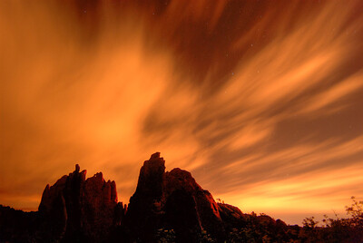© Joseph Dougherty. All rights reserved.   Garden of the Gods at night under high scattered clouds.