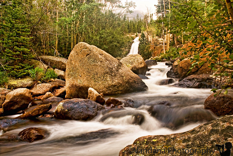 """August 19, 2006 - Alberta Falls, Rocky Mountains National Park. An early morning fall with 200-400mm in hand after running after a little blue bird left me limping and only able to do short hikes like this one.Not bad, it got me a decent waterfall and lots of <a href=""""http://vandana.smugmug.com/gallery/1773243/1/89630058/Large"""">elk</a> on the way !"""