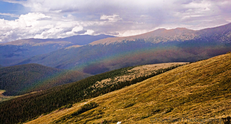 @ the highest point in Rocky Mountain National Park @ 12000+ ft. a faint rainbow below us ??!!