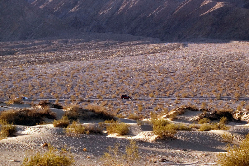 Dunes at Stovepipe Wells at sunrise.  The red truck is our SUV parked at the side of the highway.