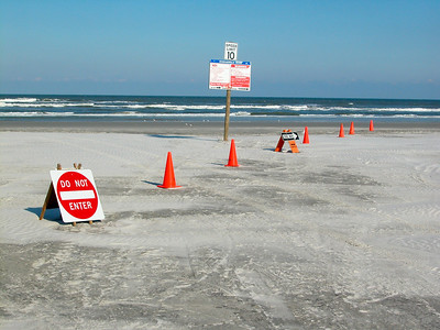 Signs indicating traffic flow on a beach in near St. Augustine, Florida. © Rob Huntley