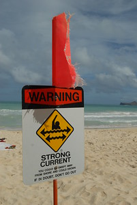 © Joseph Dougherty. All rights reserved.  Warning sign about strong currents informs swimmers and waders of the risk of longshore and rip currents.    The beach at Bellows Air Station.  Oahu, Hawaii.