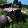 An abandoned car sits in an abandoned town not far from Helena.