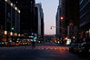 Manhattan, Dec '11<br /> Awakening city on a Sunday (7 AM)<br /> W 53rd looking up 6th Ave <br /> Professional returning home?