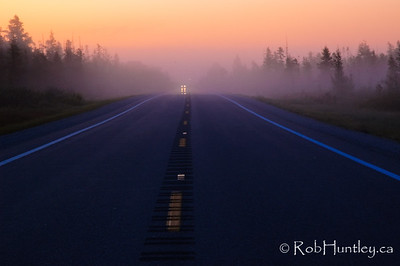 A misty sunrise on a highway in Northern Michigan.