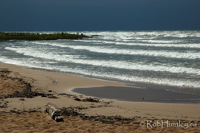 Breaking waves near Manistique Lighthouse, Manistique in northern Michigan. © Rob Huntley