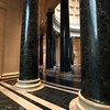 Magnificent dark columns ring the dome of the entrance.