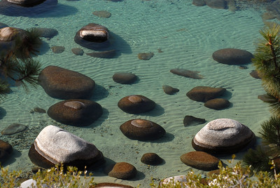 © Joseph Dougherty. All rights reserved.   Boulders sit in the torquoise shallows of Lake Tahoe like marbles dropped by a giant child.