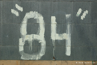 """Eighty-four painted on the side of a grain elevator in Watford City, North Dakota. Presumably a """"class of 84"""" signature. © Rob Huntley"""