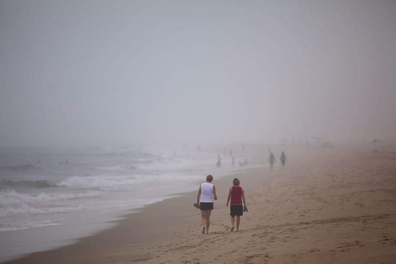 Even on a foggy day, people will make the most of the beach.