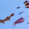 Overhead, kites fill the sky.
