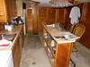 Kitchen/dining area (bare concrete in kitchen, carpet elsewhere).