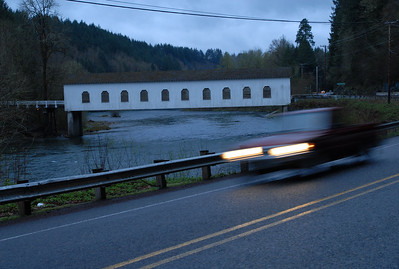 © Joseph Dougherty. All rights reserved.  Covered bridge at dusk on highway in central Oregon.