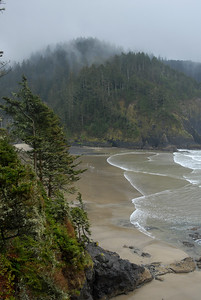 © Joseph Dougherty. All rights reserved.  Southern Oregon coast under rain and overcast skies.