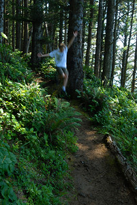 © Joseph Dougherty. All rights reserved.  Beckett running (leaping) down the Coastal Trail in Southern Oregon. August 2011.