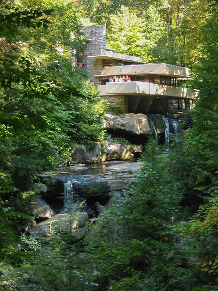 The iconic view of the house perched over Bear Run stream and waterfall.<br /> <br /> Wright did not put enough reinforcing steel into the concrete of the terraces, and they have required extensive (and expensive) re-working in recent years to keep them from collapsing, with much more steel added. Post-tensioned steel cables are now buried in the concrete of the terraces.