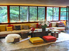 A sitting area in the living room, with Wright-designed furniture and built-in seating.