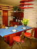 The dining area. The table and built-ins are clearly Wright-designed. The chairs may not be. The chair cushions are probably not by Wright; cute little red bows weren't his style.