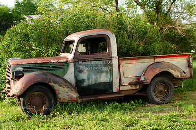 Abandoned old and rusty truck on a junk yard