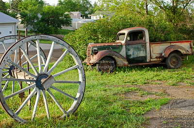 Old wagon wheels and a discarded truck