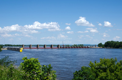 The Mississippi River Lock and Dam number 7 is located near La Crescent, MN, at the border between Wisconsin and Minnesota, right where I-90 crosses the river.