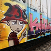 This graffiti artist put serious effort into this creation, special pains were taken to ensure that the train car's identification number remained legible.