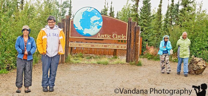 """The tourbus stops next at Arctic Circle, latitude 66'33"""""""