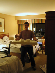 Simon holding a 26 inch pizza. That's the size of a bicycle wheel.