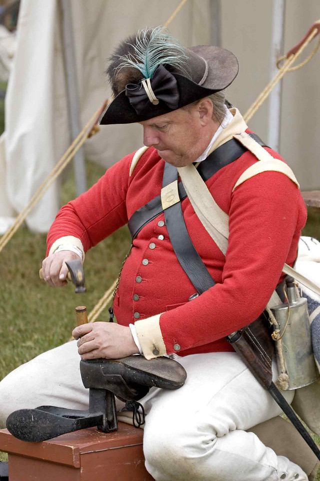 Celebration of the Victory at Yorktown 2006. Soldier in Brtish encampment repairing shoes.
